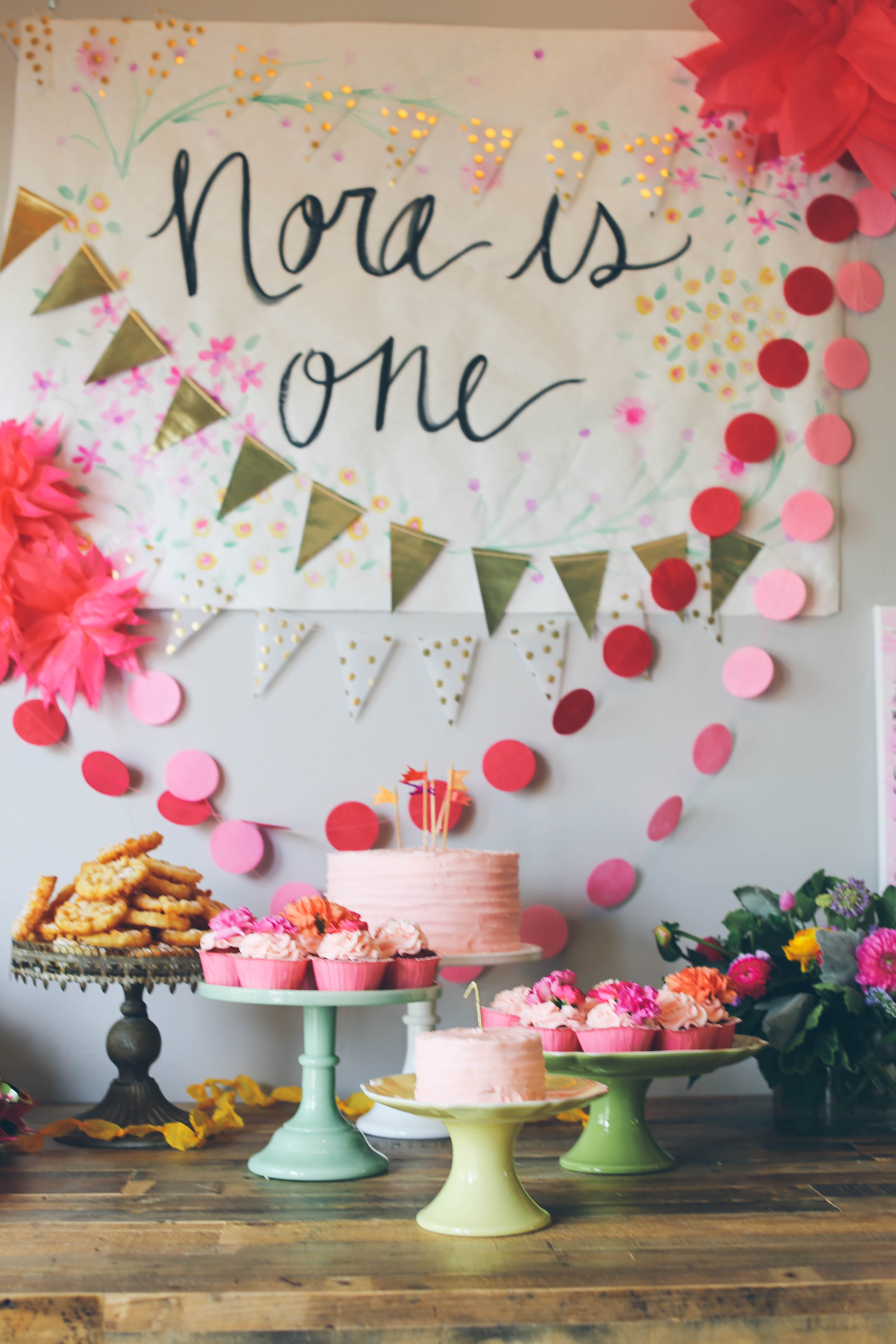 A bright garden inspired 1st birthday party hoopla events krista if you are looking for a delightful and vibrant way to celebrate a 1st birthday this beautiful garden inspired 1st birthday party by mari spiker definitely izmirmasajfo